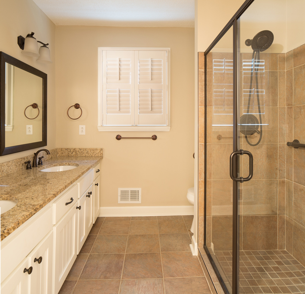 Updated bathroom with double vanity and walk-in shower