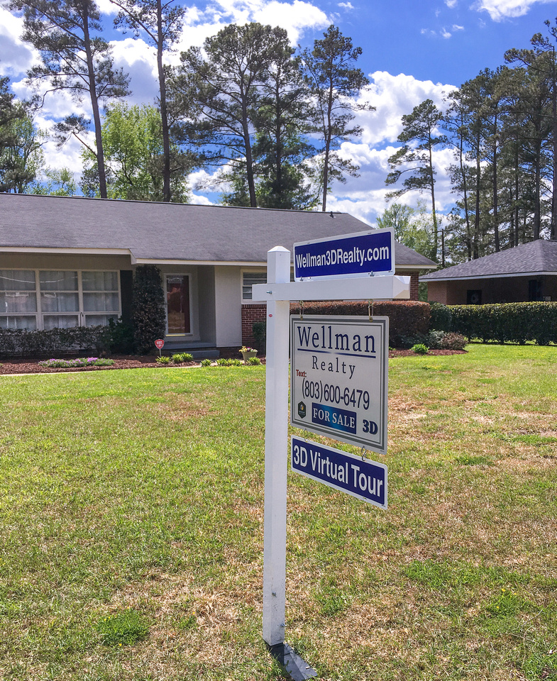 Wellman Realty For Sale Sign